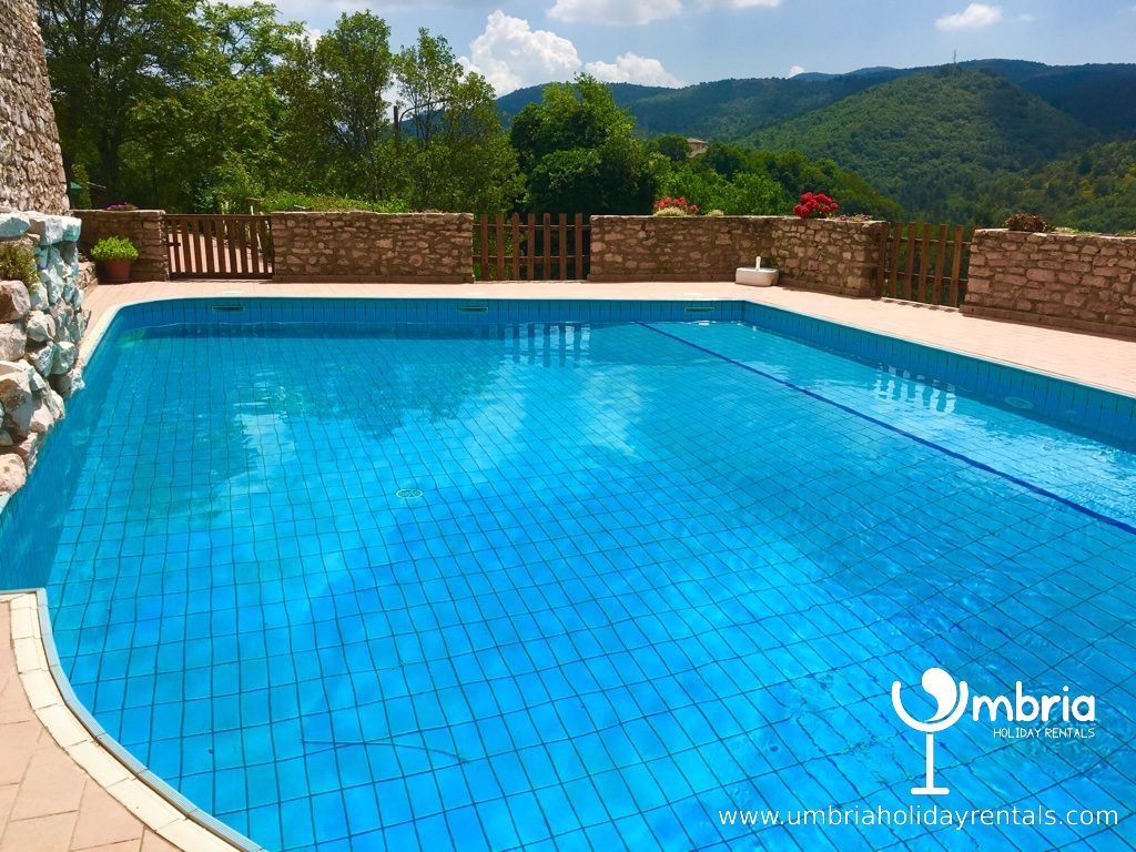 private shared pool within castle walls with sun deck, where you can eat alfreso
